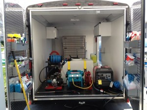 Trailer with pressure washing tools